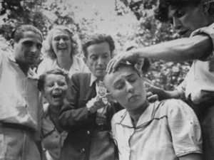 carl-mydans-female-french-collaborator-having-her-head-shaved-during-liberation-of-marseilles